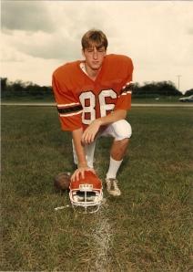 Lance in football uniform