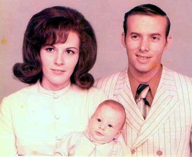 Mom, Dad and their bundle of joy
