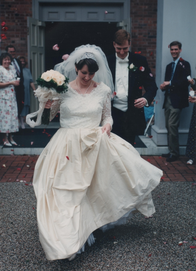 Carla and Lance run through the rose petals after their wedding 15 years ago.