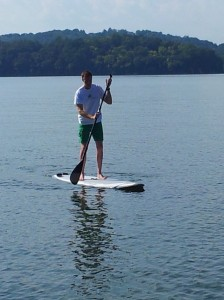 Proficient at stand-up paddle boarding