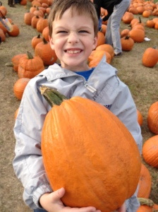 Harris with a big pumpkin