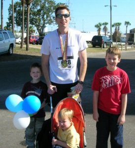 Me and the boys after the 2010 Running for the Bay Marathon in Appalachicola, Fla. I confess: I took two Ibuprofen during the race.