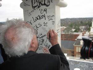 At Mercer University's 175th Anniversary in 2008, Ferrol Sams signs the Mercer tower.