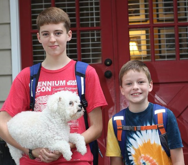 Boys with their dog on the first day of school