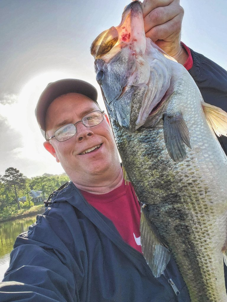 Lee Wallace holds up a six-pound bass at Lake Palestine, Texas